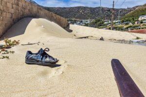 Shoe On Sandy Train Tracks